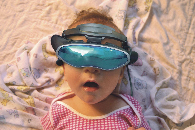 Ein kleines Kind trägt eine VR-Brille auf dem Kopf. Thema: Vierte industrielle Revolution